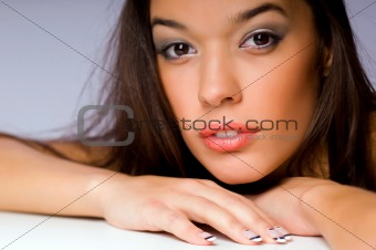 portrait of beautiful brunette woman in studio