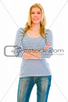 Smiling beautiful teen girl with crossed arms on chest