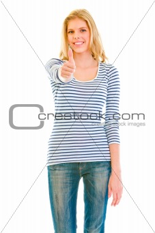 Smiling beautiful teen girl showing  thumbs up gesture
