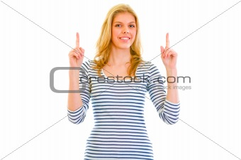 Smiling beautiful teen girl  pointing finger up