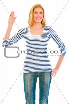 Smiling beautiful teen girl showing salutation gesture