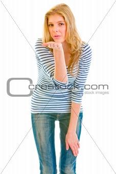 Beautiful teen girl blowing kiss at you