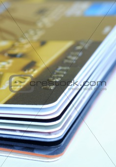 Close up view of a stack of gift cards and credit cards