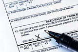 The patient signs the medical claim form