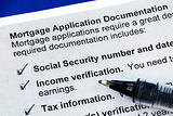 The documents required in a mortgage application isolated on blue