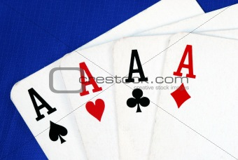 Four ace play cards isolated on blue