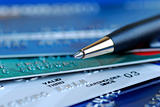 Close up view of credit cards and pen