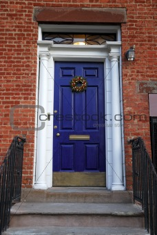 An old blue entrance door of a house