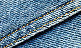 Denim material with seam running diagonally through the middle