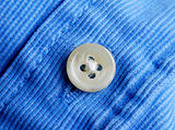 Close up view of a button from a shirt