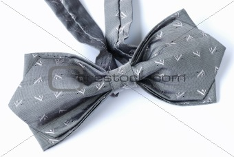 A gray bow tie isolated on white