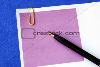 A purple sticky note isolated on blue