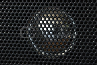 Close up view of the speaker from a radio