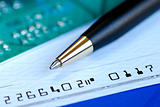 Write a check to pay the credit card bill isolated on blue