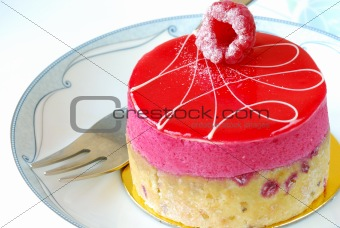 A delicious red berry pastry on a plate