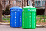 Two recycle bins for paper and bottles