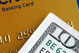 Ten dollar bill and a credit card concepts of finance