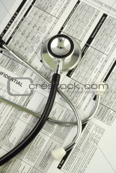 A stethoscope on the top of a medical utilization document concepts of optimizing the medical benefit