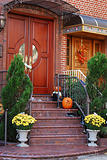 A grand main entrance of a house with halloween decoration