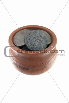 Old traditional clay mug with ancient coins