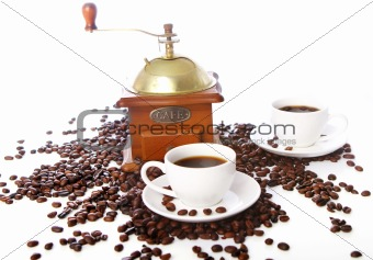 Old coffee grinder with white cup