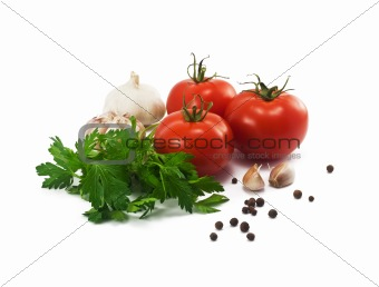 tomatoes, garlic and parsley on white background