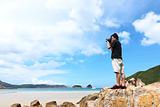 Photographer taking photo on beach