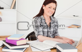 Attractive joyful girl relaxing with a laptop