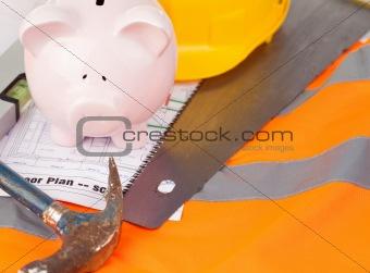 Tools and miniature house on an orange jacket