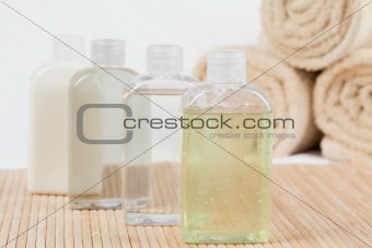 Close up of massae oil bottles and towels