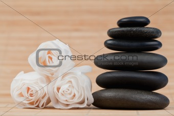 Close up roses and a black pebbles stack