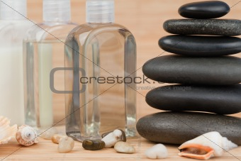 Close up of pebbles with a black pebbles stack and glass flasks