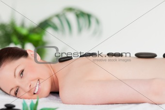 Smiling beautiful woman having a stone massage