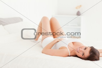 Charming brunette woman posing while lying