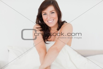 Beautiful brunette woman posing while stretching