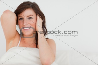 Charming brunette woman awaking while sitting