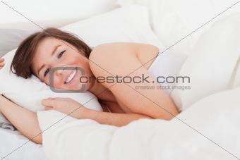 Beautiful brunette woman posing while lying