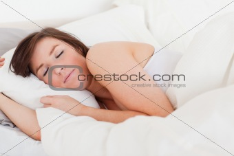 Attractive brunette female having a rest while lying