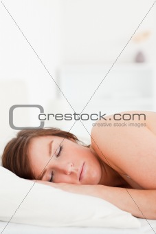 Charming brunette female having a rest while lying