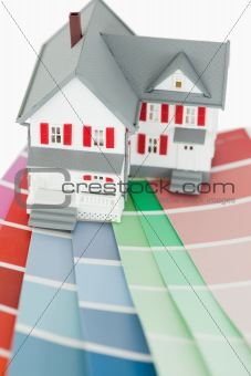 Close up of a maniature house and a color chart