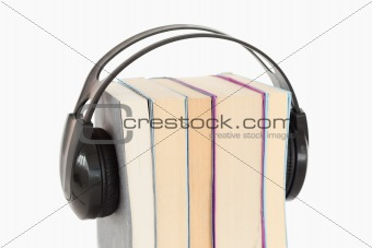 Close up of a stack of books and headphones