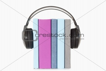 Close up of books and headphones