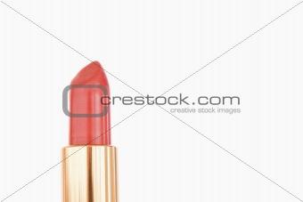 A pale red lipstick