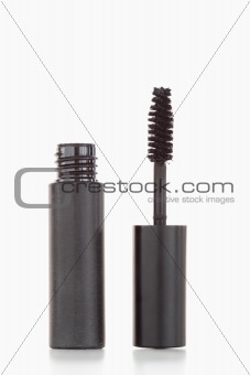 A black tube and brush of mascara
