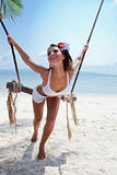 woman on a beach with swing