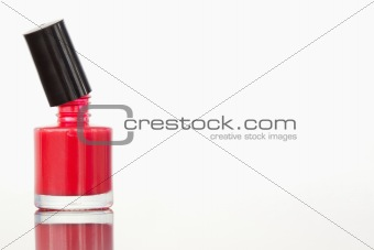 Close up of an opened nail polish flask