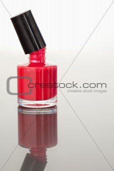 Portrait of an opened nail polish flask