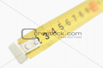 Camera focus on a yellow measuring tape
