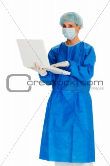 female surgeon holding laptop