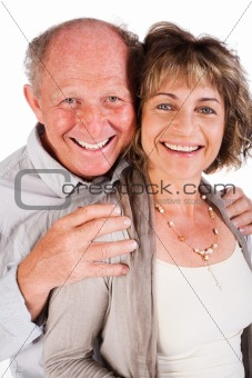 Affectionate old man hugging his wife from behind